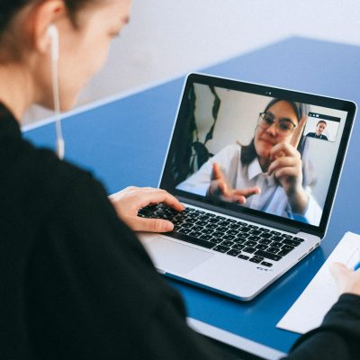 woman talking on laptop video conference
